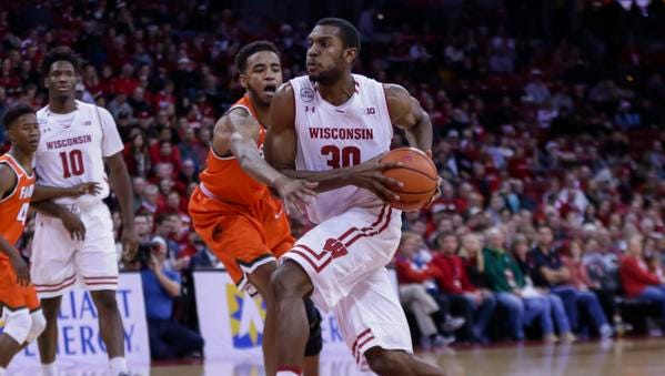 Wisconsin's Vitto Brown (30) drives against Florida A&M's Nick Severado (1) during the second half of an NCAA college basketball game Friday, Dec. 23, 2016, in Madison, Wis. Wisconsin won 90-37.