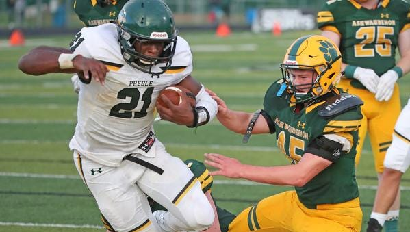 Ashwaubenon Jaguars defender Mike Vannieuwenhoven can't stop running back Henry Geil from scoring for the Preble Hornets Thursday, August 17, 2017, at Goelz Field in Ashwaubenon, Wis.