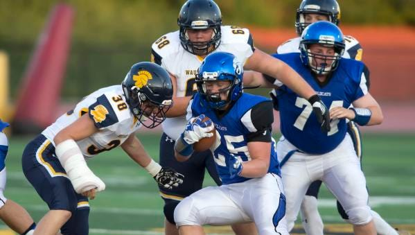 Andrew Thiele of Oshkosh West braces for a hit during an Aug. 25 game against Wausau West at Titan Stadium.