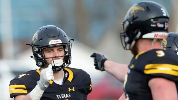 Dylan Hecker of UW-Oshkosh celebrates with Cody Moon on J.J. Keller Field at Titan Stadium after his Titan touchdown Saturday, December 2, 2017.
