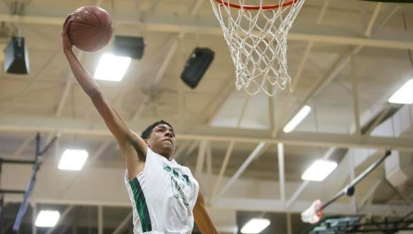 Tyrese Haliburton of Oshkosh North goes up for a dunk shot during Friday's game against Fond du Lac at Oshkosh North High School December 15, 2017.
