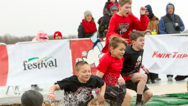 A youth Hortonville wrestling team jump into Miller's Bay for the Special Olympics Wisconsin Polar Plunge Saturday at Menominee Park in Oshkosh February 17, 2018.