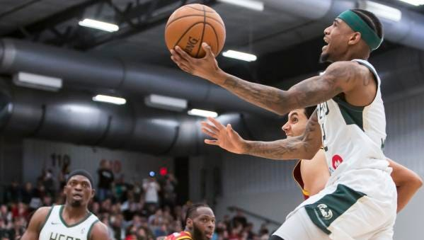Xavier Munford of the Wisconsin Herd shoots a head of Canton Charge's Grant Jerrett Friday at the Menominee Nation Arena on March 23, 2018 in Oshkosh, Wisc.