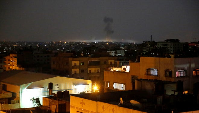 Smoke rises following an Israeli strikes on Gaza City, early Wednesday, May 30, 2018. Palestinian militants bombarded southern Israel with dozens of rockets and mortar shells while Israeli warplanes struck targets throughout the Gaza Strip in the largest flare-up of violence between the sides since a 2014 war.