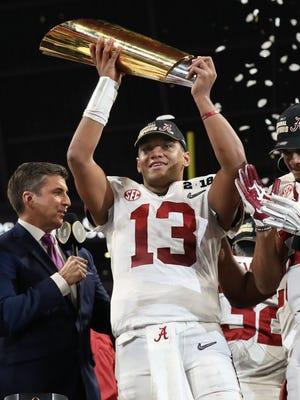 Alabama Crimson Tide quarterback Tua Tagovailoa celebrates with the trophy.