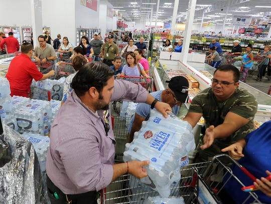 Residents purchase water at BJ Wholesale in preparation