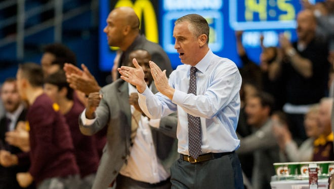 Dec 10, 2017: Arizona State Sun Devils head coach Bobby Hurley claps during the first half against the Kansas Jayhawks at Allen Fieldhouse.