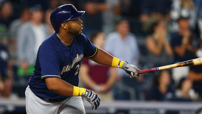 Jesus Aguilar of the Brewers hits a grand slam in the seventh inning against the Yankees on Friday night at Yankees Stadium.