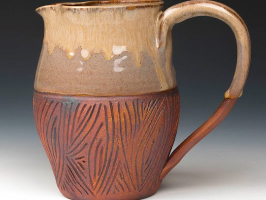 Clay pitcher by Lynn LaLuzerne of Lynn's Pottery, one of the sites on the Door County Potters' Guild Studio Tour taking place May 5-6.