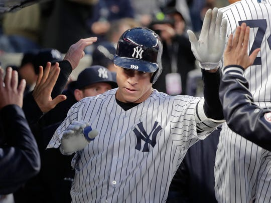 New York Yankees Aaron Judge is congratulated by teammates