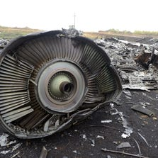 "A photo taken on September 9, 2014 shows part of the Malaysia Airlines Flight MH17 at the crash site in the village of Hrabove (Grabovo), some 80km east of Donetsk. The Malaysian passenger jet which blew up over rebel-held east Ukraine with the loss of all 298 people on board was hit by numerous ""high-energy objects"", according to a report on September 9, 2014 which could back up claims it was downed by a missile. While the preliminary report from Dutch investigators does not point the finger of blame over the July disaster, it could heighten Western pressure against Moscow over its role in the bloody Ukraine conflict. AFP PHOTO/ ALEXANDER  KHUDOTEPLY        (Photo credit should read Alexander KHUDOTEPLY/AFP/Getty Images)"