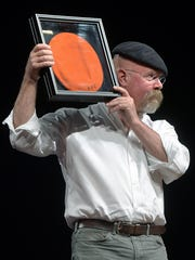 """""""Mythbusters"""" co-host Jamie Hyneman was presented with an orange RIT beret following his moderated presentation."""