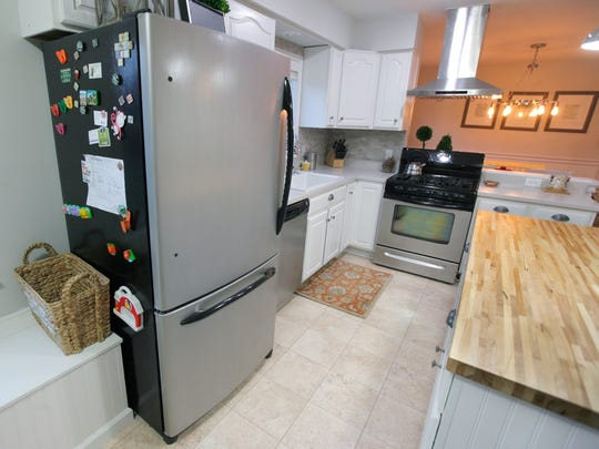Josh and Kari Kuhn painted the fridge and oven a metallic gray color to look like stainless steel.