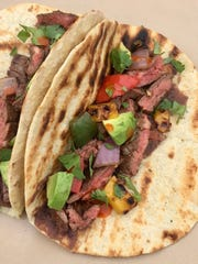 Grill the vegetables, tortillas and skirt steak in