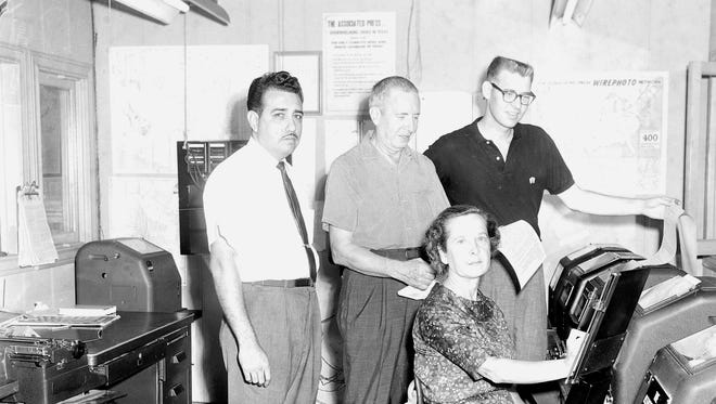 This October 1962 image shows the Associated Press staff in San Antonio, Texas in the bureau. Staffers from left to right are Mechanic-Operator Gilbert Baldarrama, Field Maintenance Man Aubrey Keel, Operator Alicia Keel, and Correspondent Charles Green.
