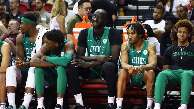 Jul 6, 2019; Las Vegas, NV, USA; Boston Celtics center Tacko Fall (center) sits on the bench with teammates against the Philadelphia 76ers during an NBA Summer League game at Thomas & Mack Center. Mandatory Credit: Mark J. Rebilas-USA TODAY Sports
