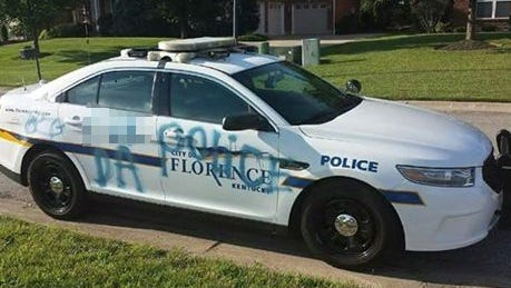Police are searching for the suspect who vandalized a cruiser.