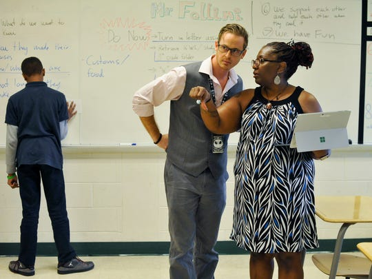 Instructional coach Evelyn Ruffin-Burris, of Camden, gives advice to Kevin Fallini on how to handle an in-class activity in his eigth grade social studies class at Bayard Middle School in Wilmington on Sept. 14. Schools across the state and the country each year lose experienced teachers and bring in new ones.