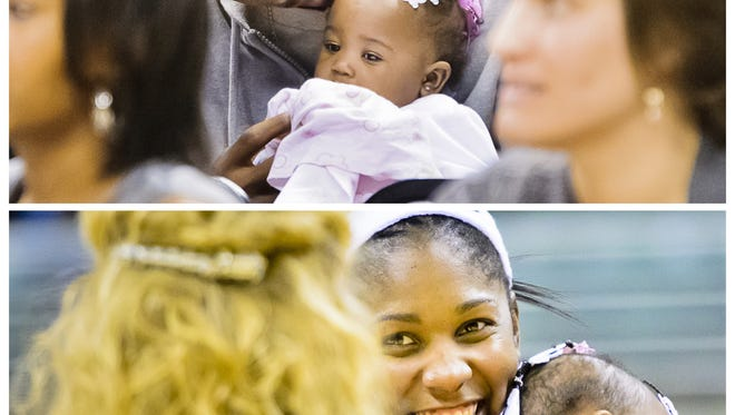 Former MSU basketball players Delvon Roe, top, and Lykendra Johnson had their daughter Destinie on Aug. 6, 2011 while they were both still students.