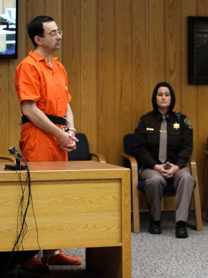 Larry Nassar stands to hear Eaton County Circuit Judge deliver his sentence Monday, Feb. 5, 2018, the third and final day of sentencing in Eaton County Court in Charlotte, Mich.. [MATTHEW DAE SMITH/Lansing State Journal]