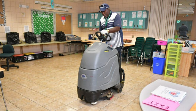 Cleaning the floors before the shelter opens JM Brown, head custodian at Imperial Estates Elementary in Titusville on Friday, as residents seek shelter from Hurricane Irma.