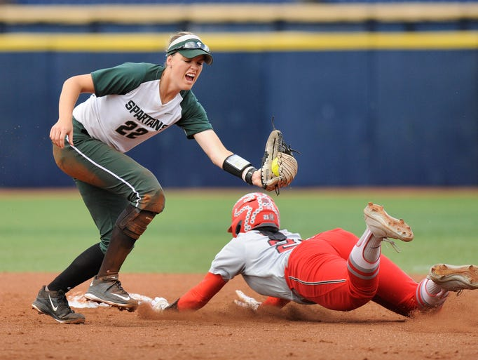 Michigan State shortstop McKenzie Long (22) reaches