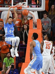 UNC forward Justin Jackson (44) dunks against Clemson during the 2nd half on Tuesday, January 3,  2017 at Clemson's Littlejohn Coliseum.