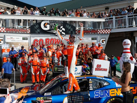 Chase Elliott celebrates his win in the Go Bowling