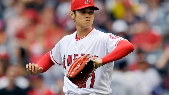 Los Angeles Angels starting pitcher Shohei Ohtani, of Japan, gestures as he gets out of the top of the first inning of a baseball game against the Tampa Bay Rays, Sunday, May 20, 2018, in Anaheim, Calif. (AP Photo/Mark J. Terrill)