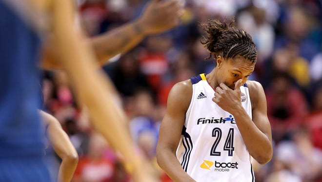 """The Fever's Tamika Catchings (24) was dejected late in the second half of the game against the Lynx Friday.  """"It's tough at times when you know what you're capable of doing,"""" she said. """"And you're like, you see the carrot swinging, and you can't get it, it keeps swinging."""""""
