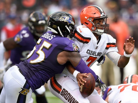 FILE - In this Sept. 17, 2017, file photo, Baltimore Ravens outside linebacker Terrell Suggs (55) strips the ball from Cleveland Browns quarterback DeShone Kizer (7) forcing a turnover during the first half of an NFL football game in Baltimore. The Ravens take on the Bears on Sunday in Baltimore. (AP Photo/Nick Wass, File)