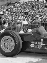 Dale Toole took over a business making seatbacks for Indy 500 fans seated on the bleachers in 1958. That was the year Pat O'Connor, shown here after qualifying for the '58 race, was killed in a terrible crash on the track.