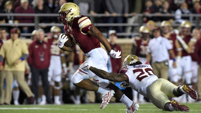 Boston College Eagles running back AJ Dillon (2) breaks the tackle of Florida State Seminoles defensive back Trey Marshall (20) during the first half at Alumni Stadium.