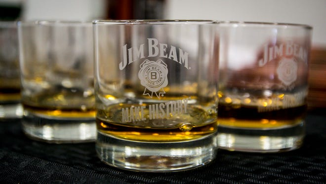 Glasses of Jim Beam were handed out for a toast at the new Jim Beam distribution plant in Frankfort, during the unveiling of an economic impact study on bourbon in the state of Kentucky.(October 21, 2014)