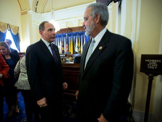 Veterans Affairs Secretary Bob McDonald, left, talks