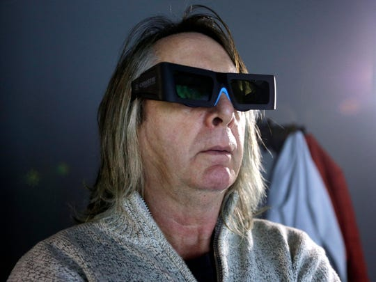 Bo Larson, director of the Macbeth play, uses 3D glasses to see the effects during rehearsal.