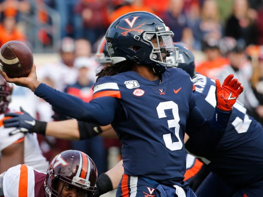 Virginia quarterback Bryce Perkins (3) tosses a pass during the second half of an NCAA college football game against the Virginia Tech in Charlottesville, Va., Friday, Nov. 29, 2019. Virginia defeated Virginia Tech 39-30. (AP Photo/Steve Helber)