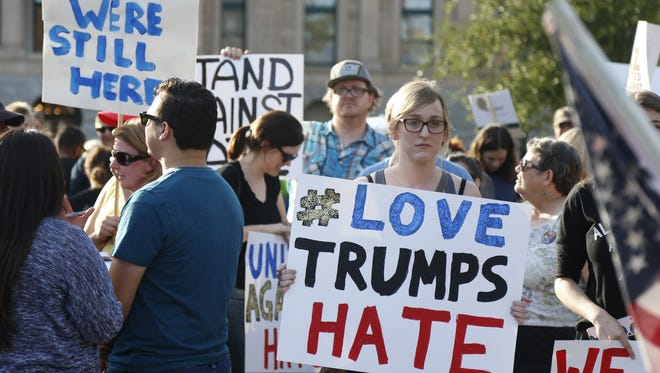 People gather to protest Trump on a march against President-elect Donald Trump  on November 12, 2016 in Phoenix, Ariz.