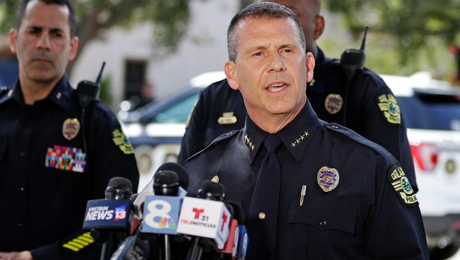 Orlando Police Chief John Mina answers questions at an afternoon news conference during a hostage standoff Monday, June 11, 2018, in Orlando, Fla. Police said a man suspected of battering his girlfriend shot a police officer late Sunday and barricaded himself inside an apartment with four young children. Late Monday, SWAT officers entered the apartment and found the suspect, Gary Lindsey, and four children dead from apparent gunshot wounds.