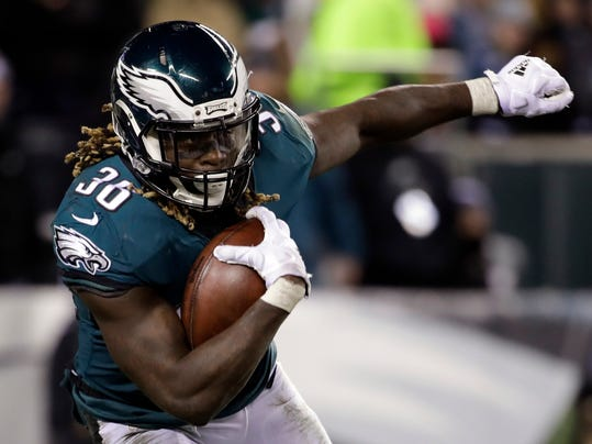 FILE - In this Saturday, Jan. 13, 2018, file photo, Philadelphia Eagles' Jay Ajayi (36) carries the ball during an NFL divisional playoff football game against the Atlanta Falcon in Philadelphia. The Eagles and the New England Patriots are set to meet in Super Bowl 52 on Sunday, Feb. 4, 2018, in Minneapolis. (AP Photo/Matt Rourke)