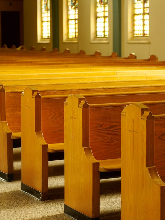 Rows of pews in church