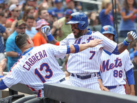 Mets third baseman Jose Reyes (7) celebrates his home run with shortstop Asdrubal Cabrera during the first inning against the Washington Nationals on Sunday. The Mets eventually lost the game 3-2.