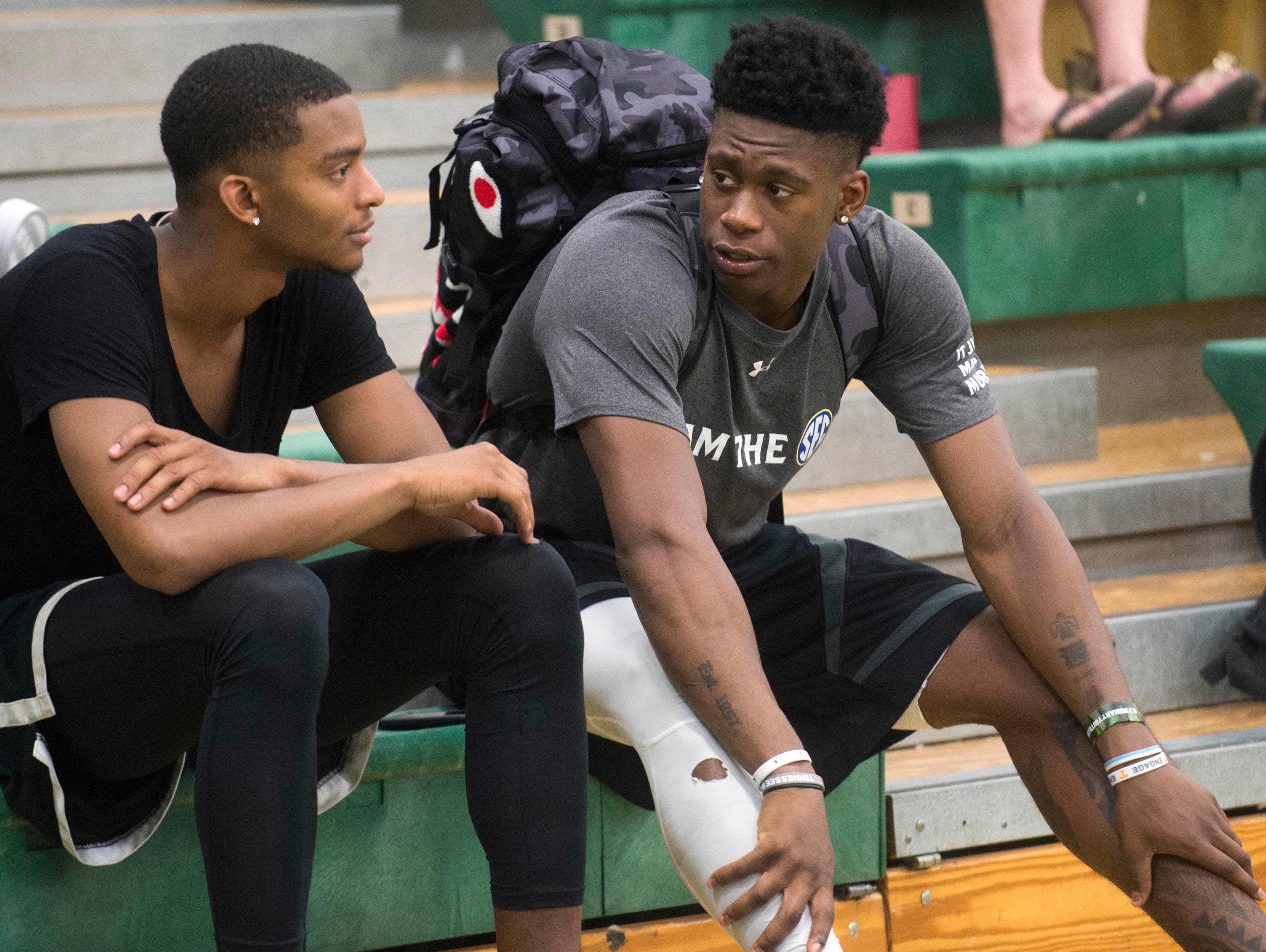 Tennessee's Admiral Schofield, right, talks with teammate Jalen Johnson while watching after their game during the Pilot Rocky Top League tournament at Knoxville Catholic High School on Monday, June 26, 2017.