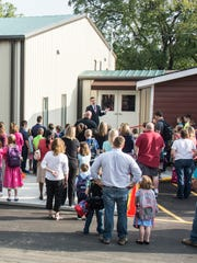 Bill Rice Christian Academy cut the ribbon on the new lower elementary school building after seven years of construction Tuesday morning and let students in for the first day of classes.