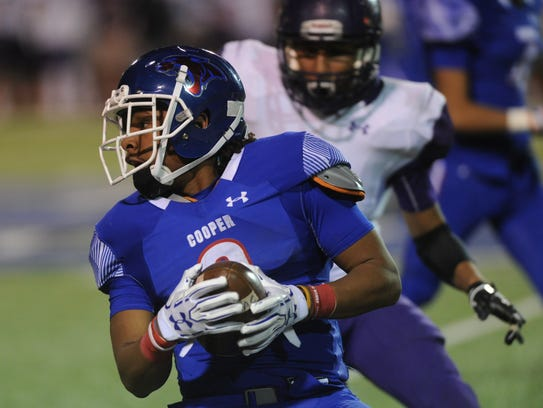 Cooper's Tyrees Whitfield carries the ball on the final