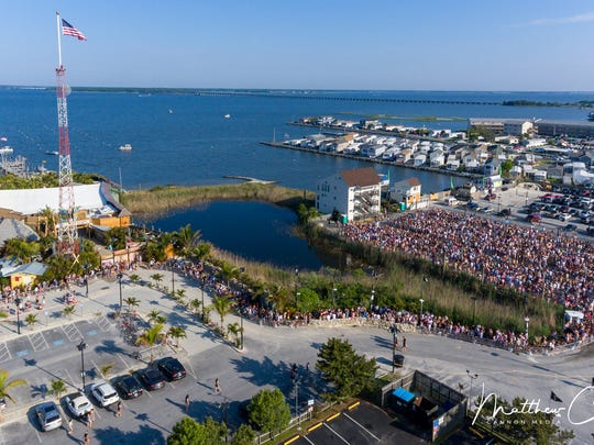 An drone photo of people waiting to get into Seacrets