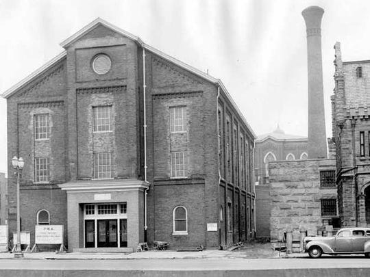 The First German Methodist Church, at the corner of Fourth and Vine streets, was built directly atop the pioneer cemetery. In the late 1800s, a boy claimed to have found the skull of Mary McGary buried in the basement of this building. McGary was the wife of Evansville's founder, Hugh McGary. She was buried in the pioneer cemetery in 1822. Photo was taken in 1937.