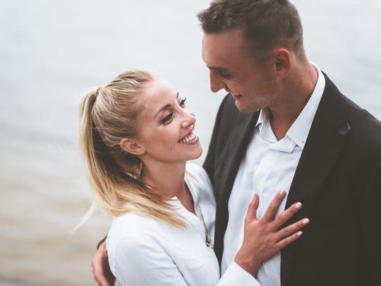 Olivia Harlan and Sam Dekker pose for their engagement