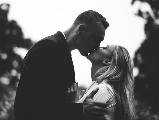 Olivia Harlan and Sam Dekker pose for their engagement