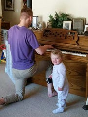 Wade Young plays piano for Clara Bolt.